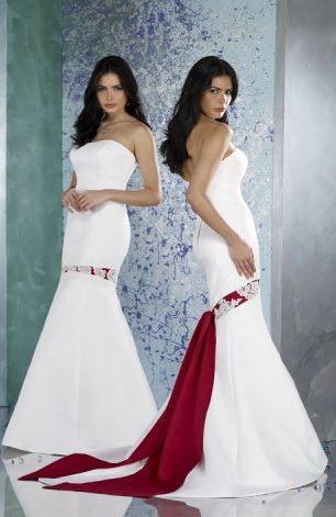 В статье черно-белое свадебное платье мы говорили о способности черных вставок делать вашу фигуру стройнее. У красного цвета немного другая роль